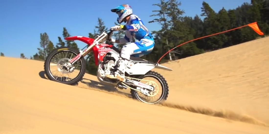 Dirt bikes jumping sand dunes